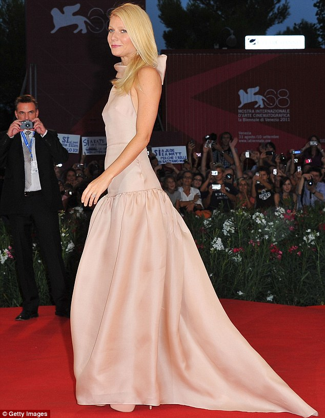 In the pink: Gwyneth Paltrow looks perfect in pink Prada during the premiere of her new film, Contagion, at the Venice International Film Festival this evening