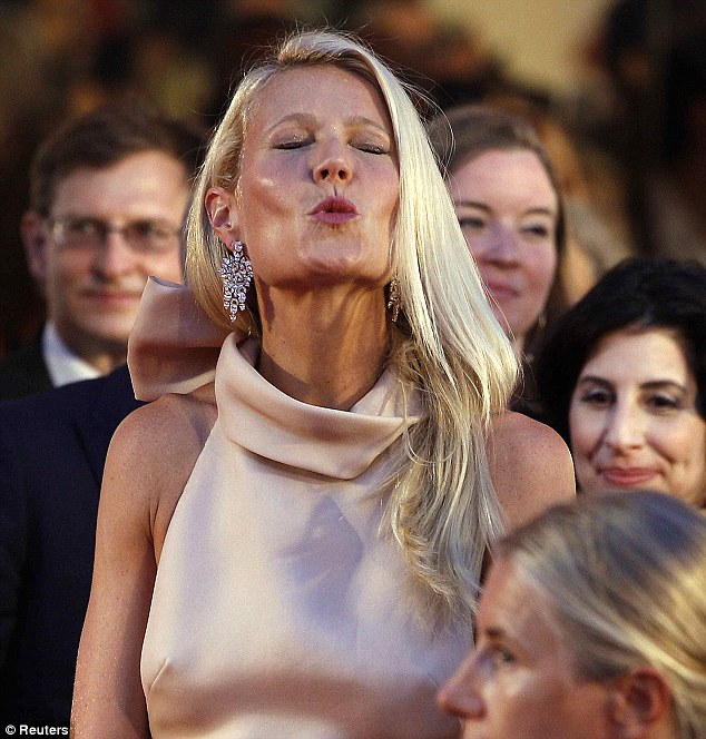 Pucker up buttercup: The elegant blonde blows kisses to the crowd