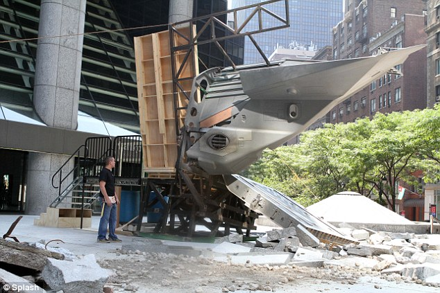 Super jet: A section of fuselage sticks into the side of a wooden prop in one area of the city