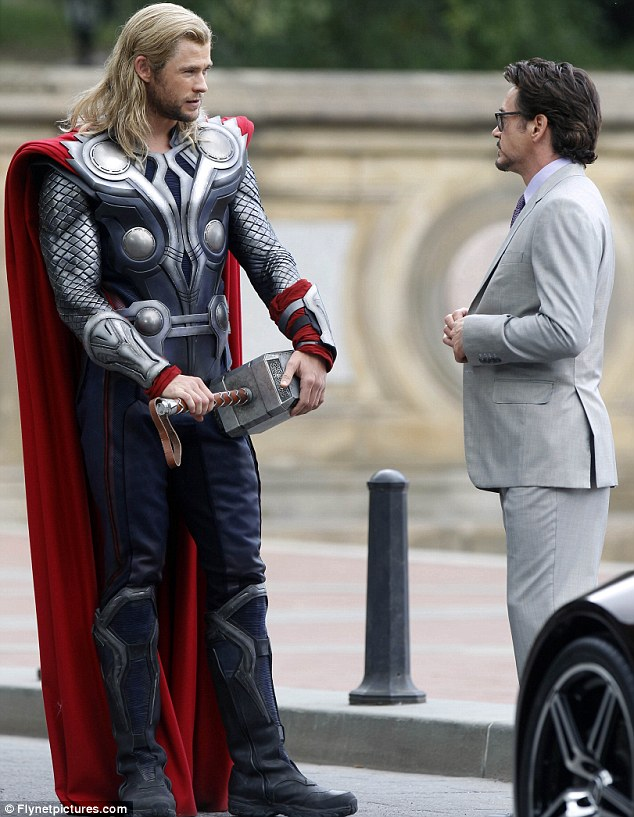 Hammering it home: Chris Hemsworth towered over co-star Robert Downey Jr as they prepared for a scene