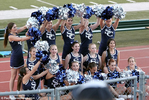 Lively bunch: Kylie and Kendall along with their fellow high school peers with pom poms in hand