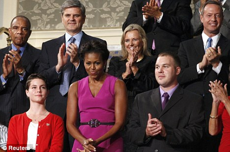 High level applause: Kenneth Chenault, CEO of American Express, (back row, far left) is among several prominent African-Americans who have lauded Mr Obama's plan