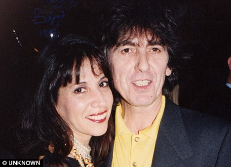 Long suffering: George with his wife Olivia who believes he had several affairs