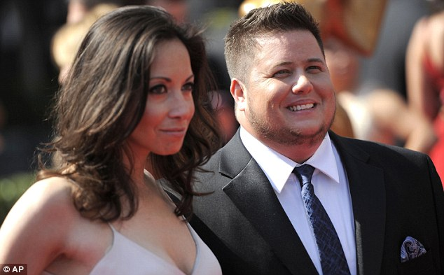So happy together: Chaz Bono and his loyal girlfriend Jennifer Elia soak up the atmosphere at the Creative Arts Emmy Awards in LA tonight