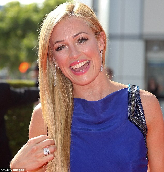 What a beauty: Cat Deeley looked stunning in her vivid purple gown