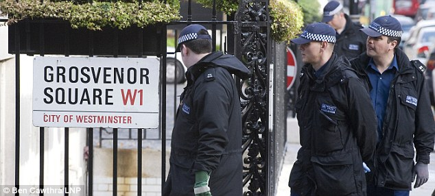 Security check: Police officers search Grosvenor Square where a remembrance service was held for the British 9/11 victims