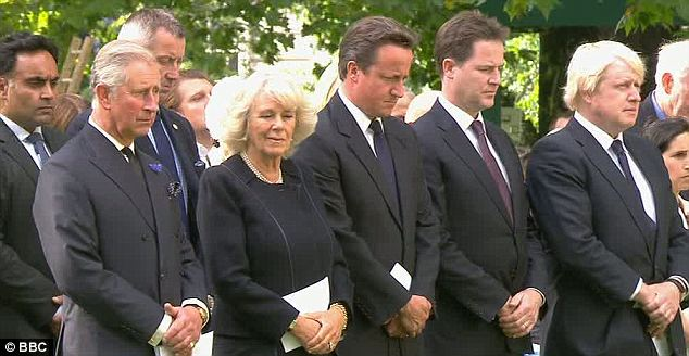 Solemn: Prince Charles and the Duchess of Cornwall, Prime Minister David Cameron, Deputy Prime Minister Nick Clegg and London Mayor Boris Johnson pay their respects