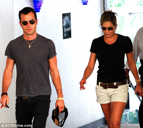 Distraught: Jennifer Aniston, pictured here running errands with Justin Theroux in Beverly Hills on Saturday,  visited her mother's hospital bedside over the weekend
