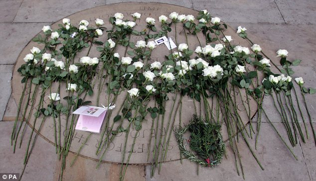 Tribute: A white rose was left for each of the 67 British victims of the 9/11 attacks
