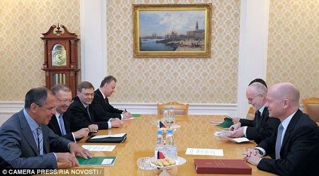Russian Foreign Minister Sergei Lavrov (left) conducts talks with his British counterpart, William Hague (right)