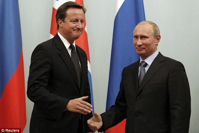 Counterparts: Russian Prime Minister Vladimir Putin shakes hands with his British equivalent in Moscow