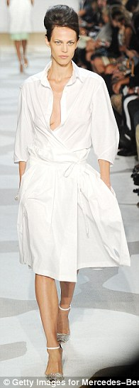 White out: A rare print-free outfit in the form of a wrap-tie shirt dress