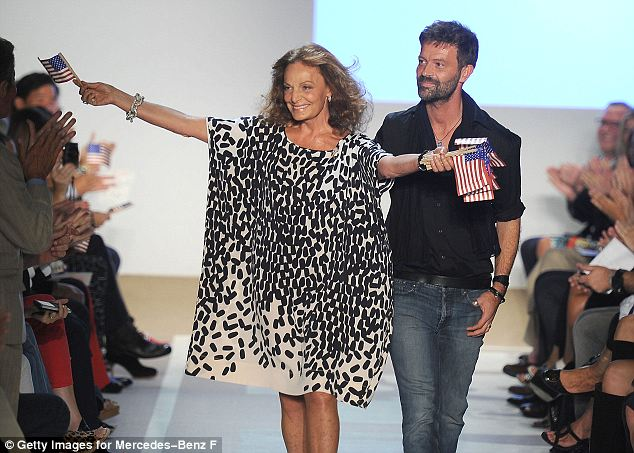 Appreciative crowd: Diane von Furstenberg takes to the runway with creative director Yvan Mispelaere to thunderous applause