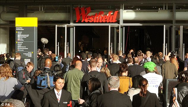 Crowds gather: Press and the public jostle for space outside Westfield Stratford City as they prepare for the 10am official opening