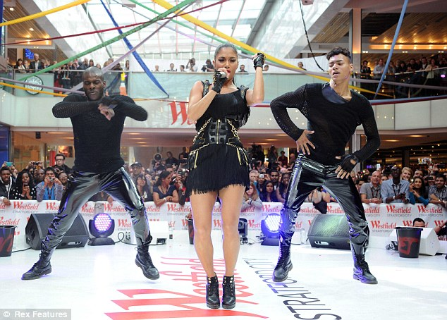 Hysteria: Excitement reached fever pitch as Nicole Scherzinger performed to the crowds gathered at the new Westfield shopping centre in Stratford