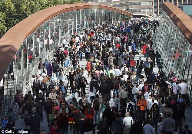 Olympic gateway: Shoppers walk to the newly opened Westfield Stratford City shopping centre across the bridge that will take Games visitors to events in 2012