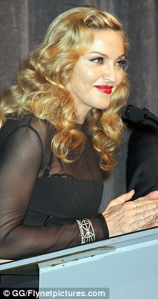 Powerful: Madonna has the crowd eating out the palm of her hand with a flash of her smile