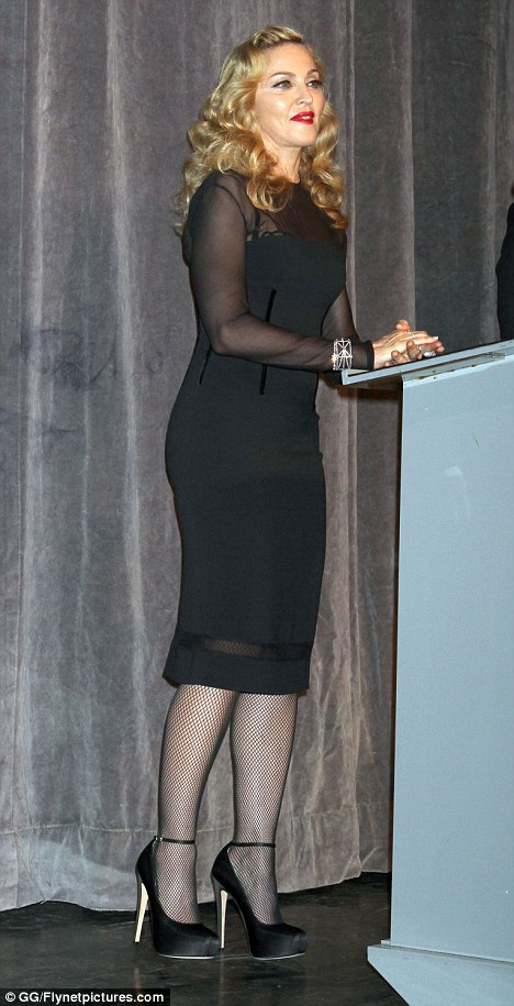 Material Girl: Madonna teetered on heels as she addressed the media at a press conference