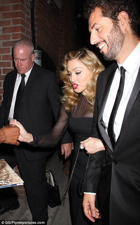 Companions: Madonna walked arm-in-arm with her manager Guy O'Seary as they headed to a private aftershow party