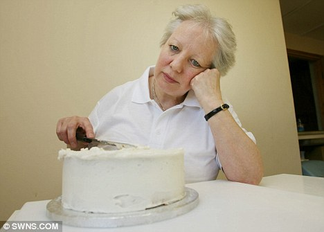 Upset: Cake decorator Avril Unwin is one of 1,000 who have been told she is not allowed to use any Olympic logos on her cakes due to copyright