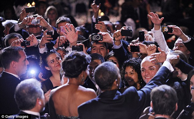 Pleasant greeting: The US President and First Lady were greeted by crowds of fans with their cameras at the Annual Awards Gala