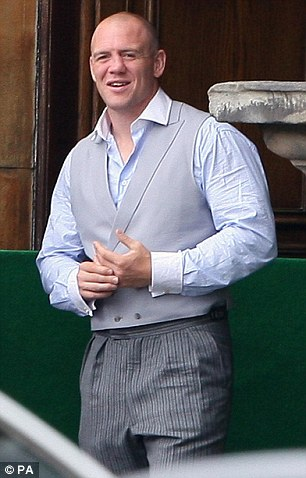 Partying hard: Tindall was still wearing his morning suit the afternoon after his wedding to Zara in July