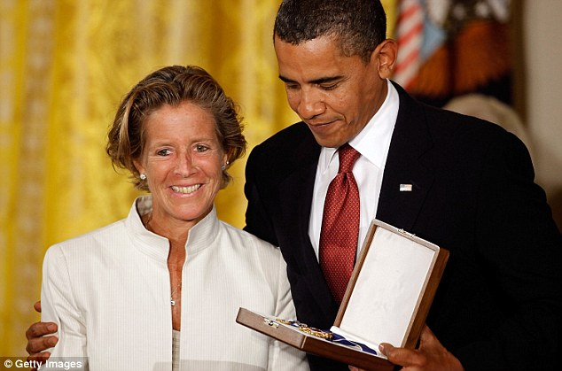Proud: Kara accepts her father's Medal of Freedom on his behalf from President Barack Obama in 2009