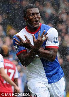 That's handy: Yakubu celebrates a strike against Arsenal
