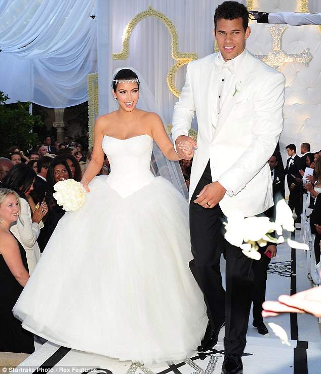 They did!: Kim Kardashian and Kris Humphries are elated after exchanging their vows at an estate in Montecito