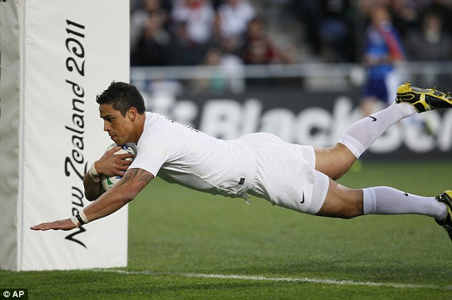 Great start: Shontayne Hape dives over the tryline to put England ahead early on