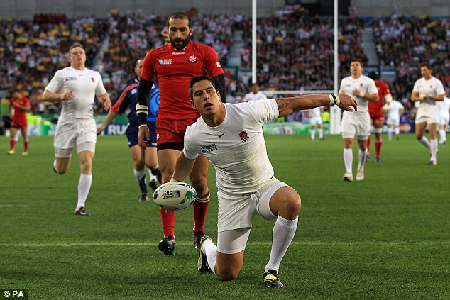Try time: The England centre  celebrates his early score against Georgia