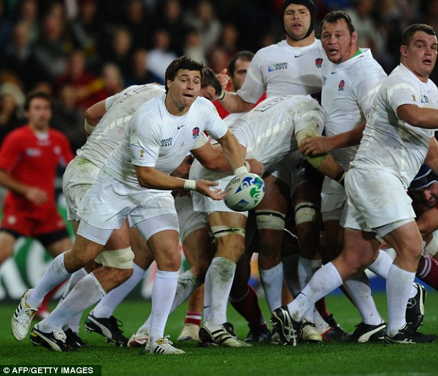 Pass master: England scrum-half Ben Youngs (left) delivers the ball to his backs