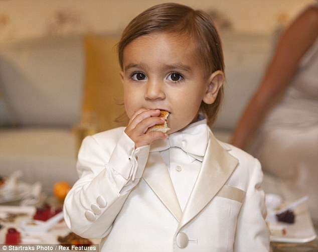 Big role: Kim's 21-month-old nephew Mason made for an adorable page boy