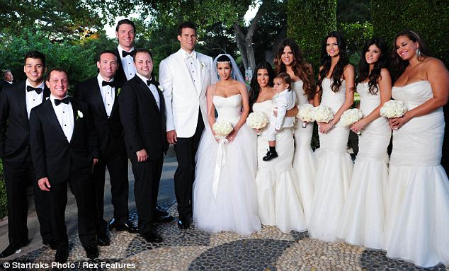 Happy day: The wedding photo shows Kris and Kim with their Wedding Party in idyllic surroundings