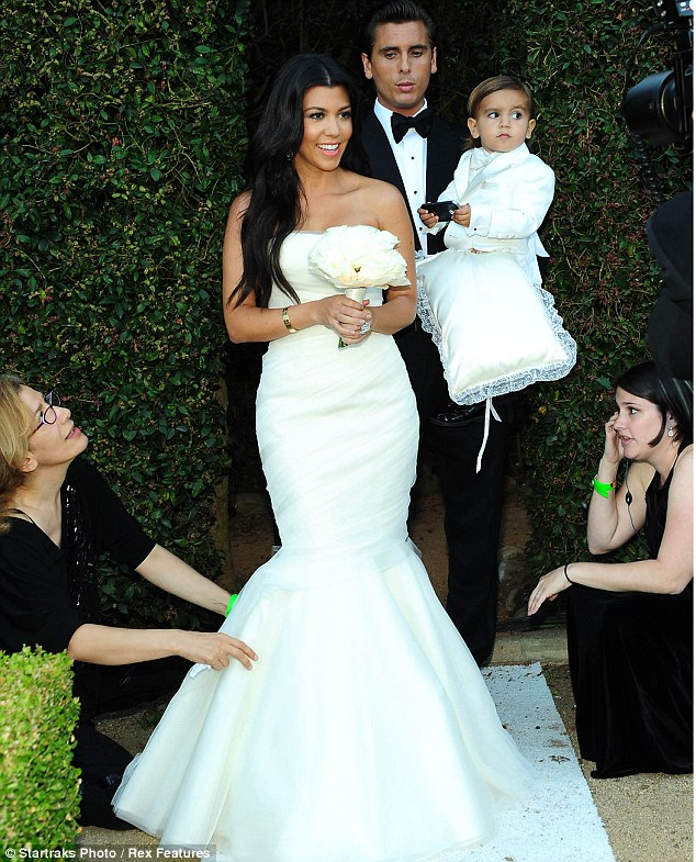 Dashing family: Kourtney, Scott and Mason looked lovely as they headed to the ceremony