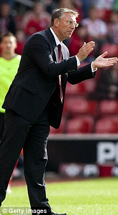 Year to remember: Nigel Adkins' side have won 13 home games in a row
