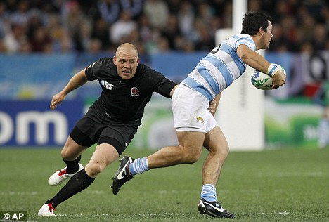 Centre Tindall is shown tackling an Argentina player at the World Cup, hours before he went out to 'relax'