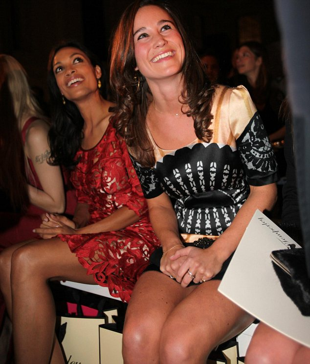 Happy: Pippa, right, and actress Rosario Dawson, left, were all smiles as they waited for the show to begin