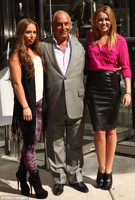 Towering ambition: Chloe Green wearing sky-high Louboutins at the Topshop opening in Chicago with her father Sir Philip Green and Miley Cyrus, who at 5' 4'' still towers above the Greens