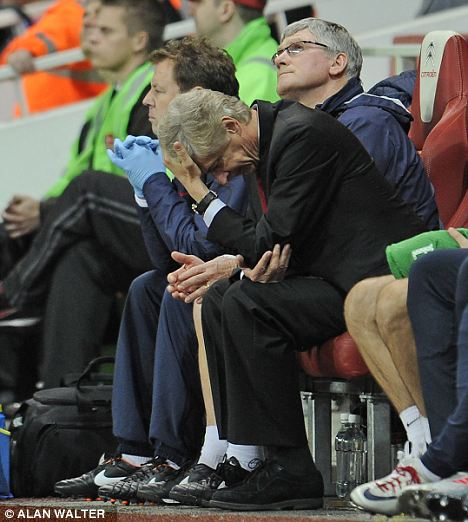 Testing times: Wenger shows the strain during the clash with the Shrews