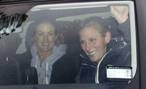 Chin up: Zara Phillips leaves the Auckland lodge where she is staying as she prepares to see her husband