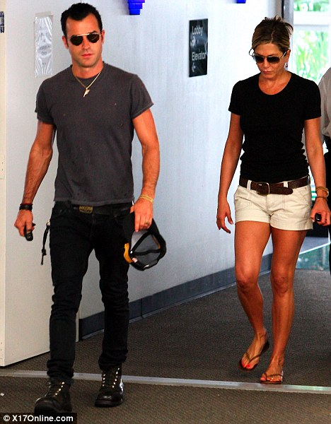 They even walk the same walk! With matching toned biceps the couple mirror each other during a visit to a skin clinic in Beverly Hills this month
