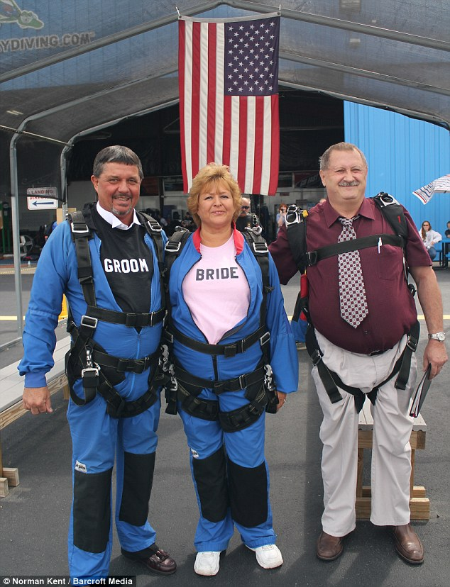 Cold feet? Phil Mathis and Gail Mathis pose before taking their wedding day skydive in Middletown, Ohio