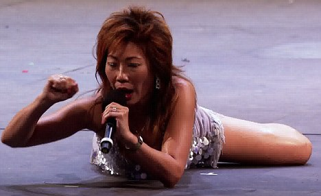 Quirky: Goldie gave it her all during her performance, even writhing on the stage floor for effect