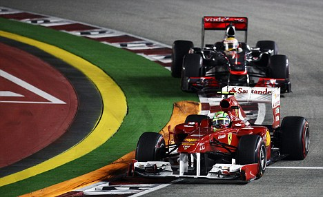 Dog fight: Hamilton tried to overtake Massa in Singapore and the pair later clashed again