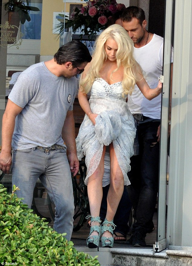 Off to the set: Plein, the white t-shirt, and another member of his fashion team accompanied Lindsay
