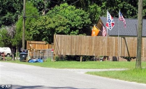 Fight: Dozens protested last October when Caddell placed a Confederate flag on her porch in her historically black neighborhood