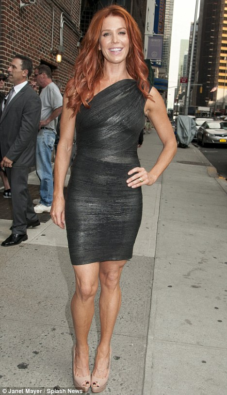 Red hot: Poppy Montgomery looks gorgeous in a shimmering black bandage dress at the Late Show with David Letterman in New York