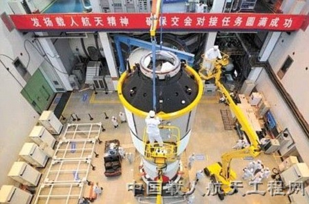 Under construction: Engineers prepare part of the Tiangong-1 module which will be propelled into space as part of China's ambition to build a space station