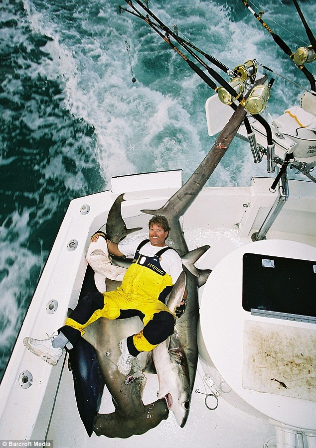 What a catch: Mark with a 12ft long thresher shark and a 7ft long hammerhead shark in Miami